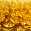 Golden coins and gold sand — Stock Photo
