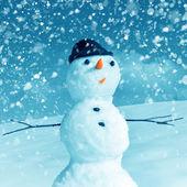 Snow man in santa cap — Stock Photo