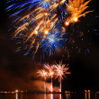 Stock Photo: Colorful firework in night sky