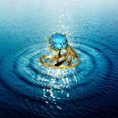 Jewelry ring in water waves — Stock Photo