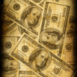 Old paper background with dollars — Stock Photo