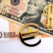 The money euro and dollars and golden sign — Stock Photo