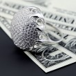 Stock Photo: Americdollars and jewelry diamond ring