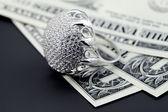 American dollars and jewelry diamond ring — Stock Photo