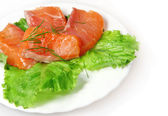 Salty salmon with green lettuce — Стоковое фото