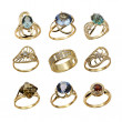 Set of elegant female jewelry golden rings — Stock Photo