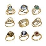 Set of elegant female jewelry golden rings — Stock Photo