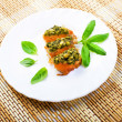 Slices of a salmon baked under a crust from sauce pesto — Stock Photo