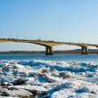 Stock Photo: Bridge . Drifting Ice on river Volga.