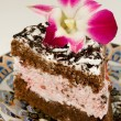 Tasty dessert with flower orchid — Stock Photo