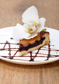 Tasty pie with flower orchid — Stock Photo