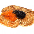 Salmon  and beluga caviar with russian pancakes — Stock Photo