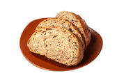 Black bread with bred grains — Stock Photo
