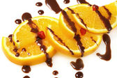 Fruit orange with chocolate glaze — Stock Photo