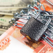 Money and lock — Stock Photo #37332227