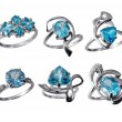 Stock Photo: Set of golden jewelry rings with blue topaz