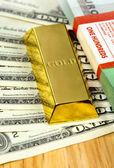 Money and gold bullion — Stockfoto