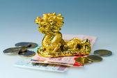 Money and golden dragon — Stock Photo