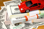 The money euro and dollars and small automobile — Stock Photo