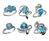 Set of golden jewelry rings with blue topaz — Stock Photo