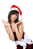 Charming young woman in santa cap — Stock Photo