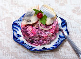 Food - russian snack - vinaigrette with herring fish — Stock Photo