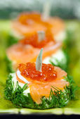 Snack with red salmon caviar — Stock Photo