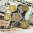 Many money euro and dollars and coins — Stock Photo #37512447