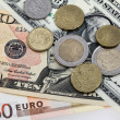 Many money euro and dollars and coins — Stock Photo