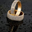 Stock Photo: Golden jewelry two rings