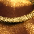 Golden jewelry bracelet — Stock Photo