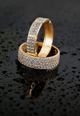 Golden jewelry two rings — Stock Photo