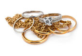 Golden jewelry on white — Stock Photo