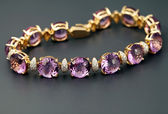 Golden jewelry bracelet with amethysts — Stock Photo