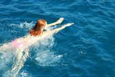 Girl in Aegean sea — Stock Photo