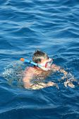 Boy in Aegean sea — Stock Photo
