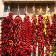 Постер, плакат: Cayenne in a shop of Naples