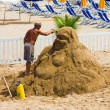 The man has made a sculpture of sand on a beach — Stock Photo