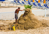 The man has made a sculpture of sand on a beach — Foto Stock