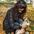 Young woman and small dog siberian husky — Stock Photo #39843493