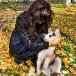 Young woman and small dog siberian husky — Stock Photo