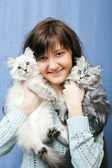Girl with kittens — Stock Photo