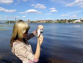 Girl photographing river — Stock Photo