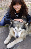 Dog Alaskan Malamute and young woman — Stock Photo
