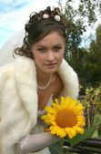 Beautiful bride and sunflower — Stock Photo