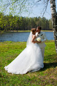 Bride and groom, kiss — Stock Photo