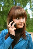 Woman with telephone — Stock Photo