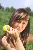 Girl holding an apple — Stock Photo
