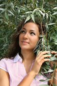 Girl near the tree branches — Stock Photo