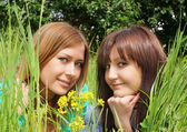 Girls in a yellow flowers — Stockfoto